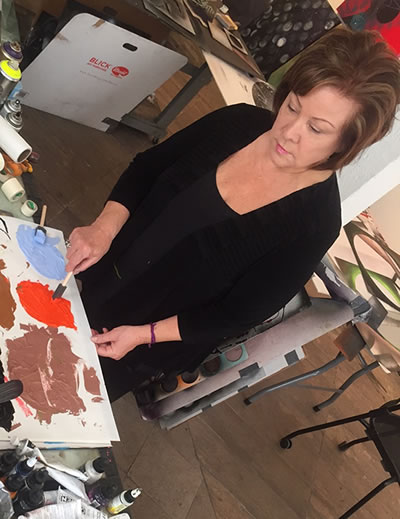 Nola Zirin working in her studio